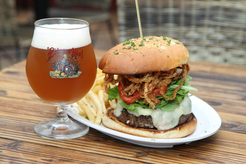 A burger and beer is many customer's signature order at The Public House in La Jolla. Its house-specialty is a 10-ounce, grass-fed Kobe Wagyu Burger with the meat from Australia's Greg Norman Farms. The hefty burger is served with Gruyere cheese, crumbly gorgonzola, crispy onion straws, tomato and