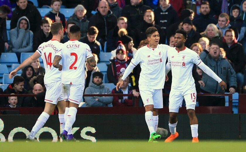 Liverpool's Daniel Sturridge, right, celebrates with team-mate Roberto Firmino after scoring his side's first goal during their English Premier League soccer match against Aston Villa at Villa Park, in Birmingham, England, Sunday Feb. 14, 2016. (Nick Potts/PA via AP) UNITED KINGDOM OUT