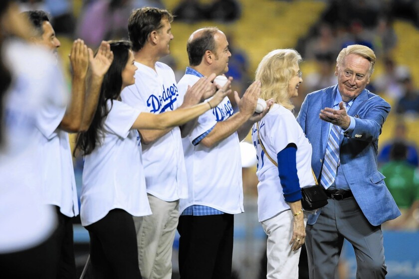 "Announcer Vin Scully said Wednesday that he was not entirely comfortable ""to have my name tossed into a negotiation."""