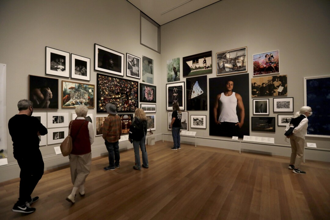 """Visitors take in a new show titled, """"Photo Flux: Unshuttering LA,"""""""