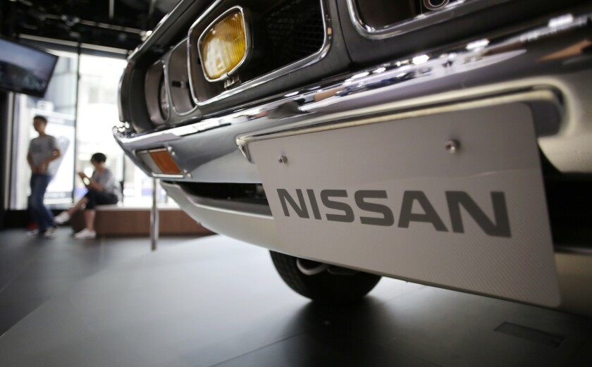 FILE - In this May 11, 2017 file photo, a Nissan car is displayed at its showroom in Tokyo. Nissan is recalling 1.3 million vehicles in the U.S., Canada and other countries to fix a problem with backup camera displays. The recall covers most of the Nissan and Infiniti model lineups from the 2018 and 2019 model years. (AP Photo/Eugene Hoshiko, File)
