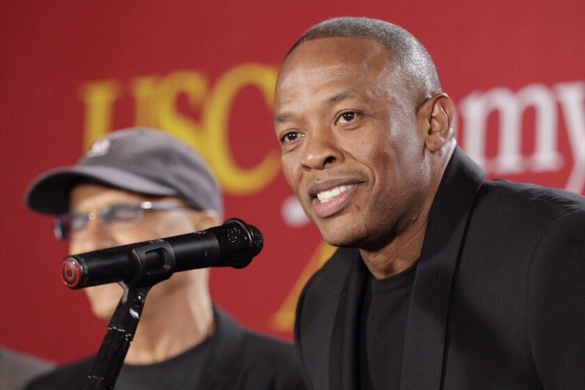 "Jimmy Iovine, the co-founder of Interscope Records, left, stands with partner hip-hop mogul Dr. Dre, as they announce a $70 million dollar donation to create the new ""Jimmy Iovine and Andre Young Academy for Arts and Technology and Business Innovation"" at the University of Southern California during a news conference at in Santa Monica."