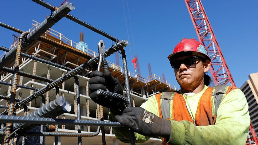 Lorenzo Robbins and other Local 229 ironworkers build a rebar column near what will become a Garden Communities residential high-rise on La Jolla Village Drive.