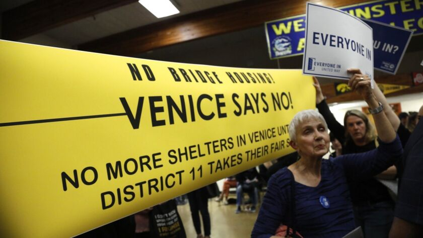 Residents for and against a planned emergency shelter for homeless people attend an open house on the topic at Westminster Elementary School in Venice on June 13.