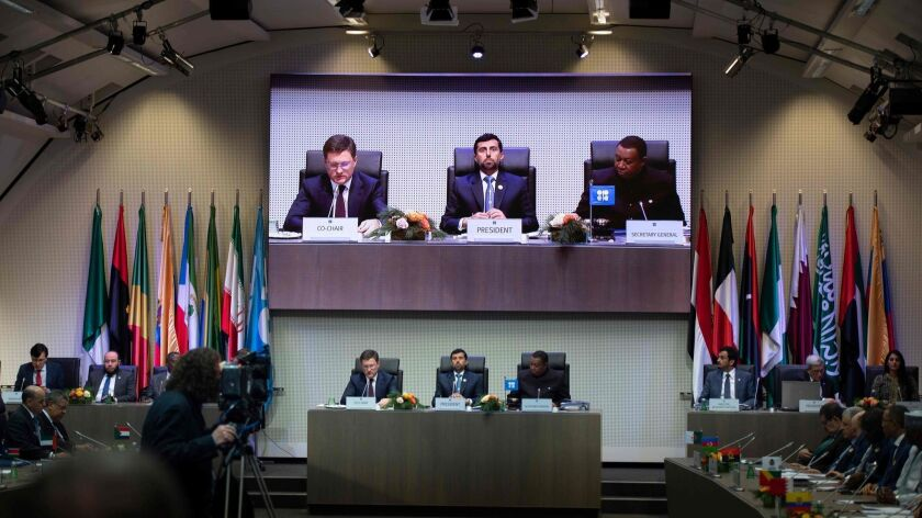Russian Energy Minister Alexander Novak, from left, OPEC President Suhail Mazroueiand of the United Arab Emirates and OPEC Secretary-Gen. Mohammed Sanusi Barkindo of Nigeria lead a meeting Friday in Vienna.