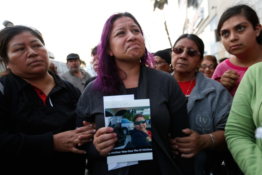 "Jennifer Ruiz, 26, attends a vigil in Los Angeles for her mother, Rosa ""Rosalba"" Ruiz, who was one of 13 people killed in the tour bus crash in Desert Hot Springs."