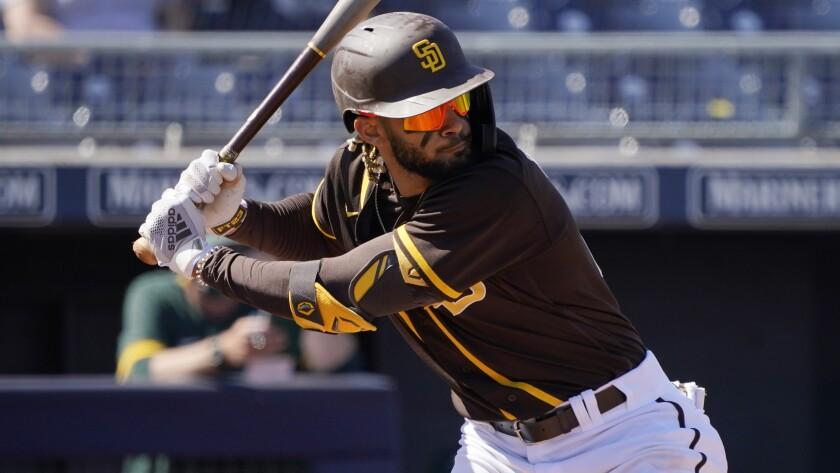 San Diego Padres' Fernando Tatis Jr. bats during a spring training game.