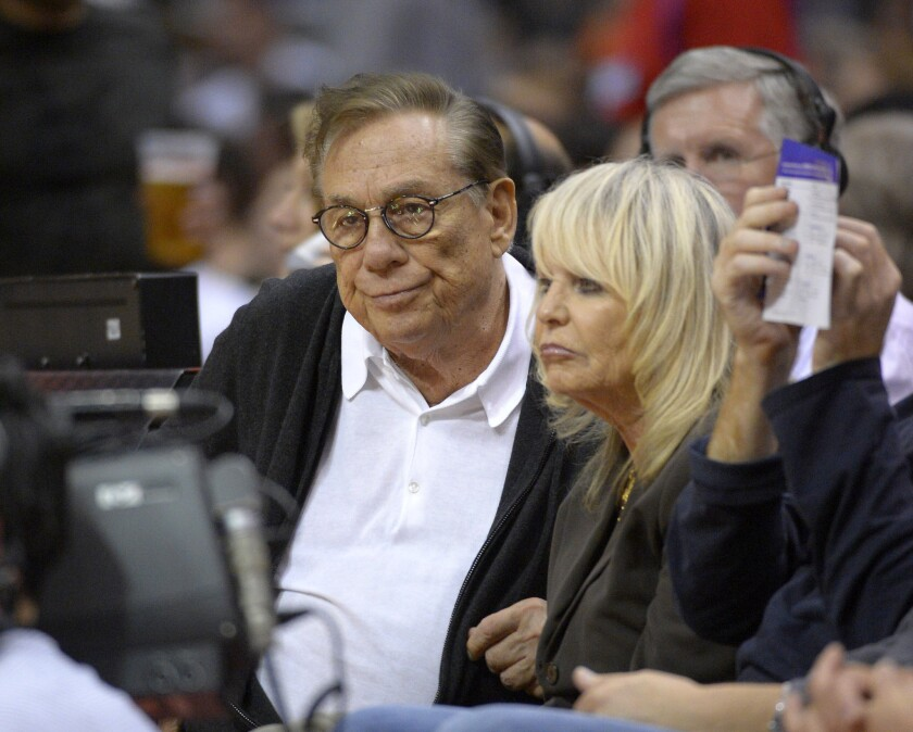 Then-Clippers owners Donald Sterling and his wife Shelly Sterling watch the team play the Spurs on Nov. 7, 2012.