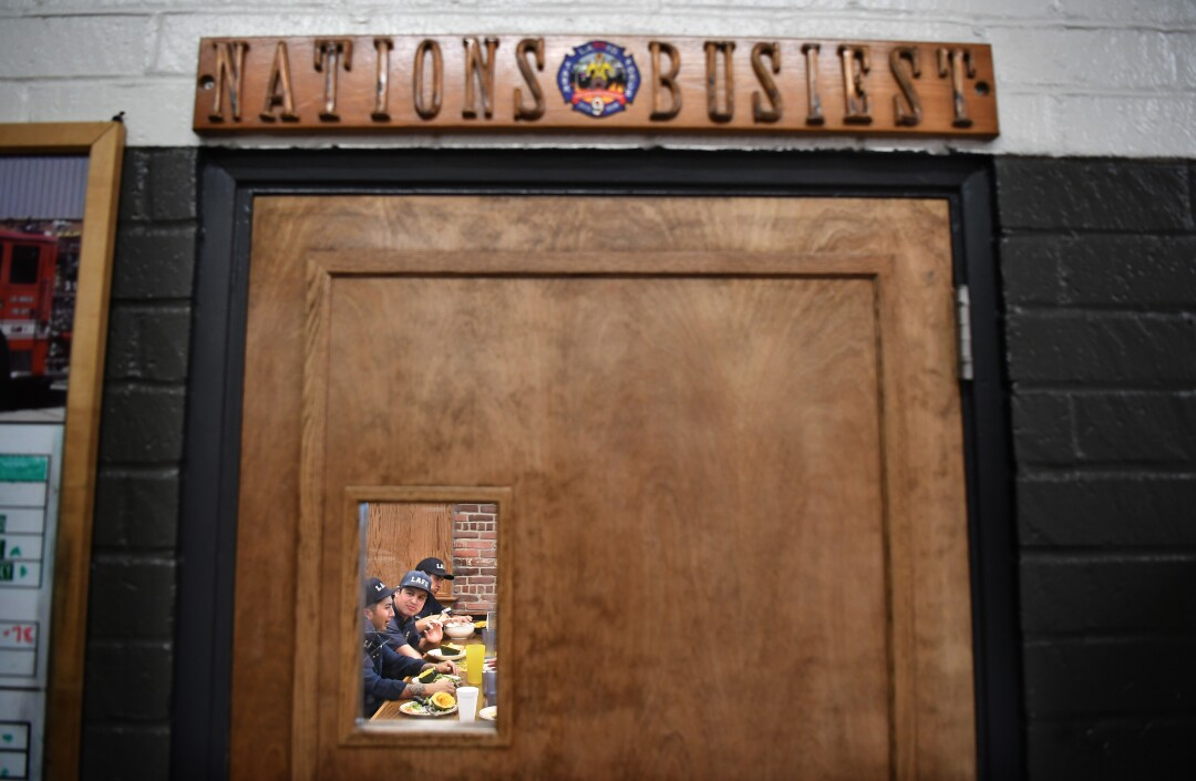 Los Angeles firefighters eat a meal at Fire Station No. 9