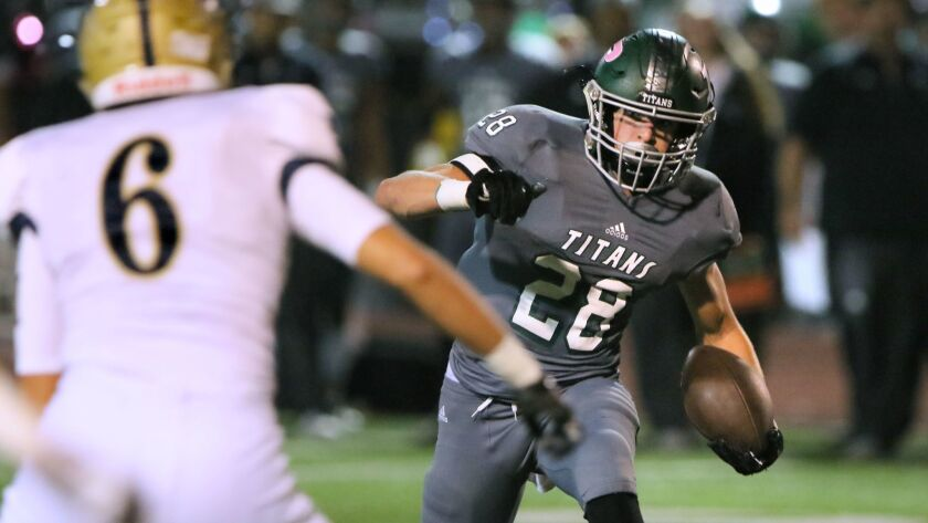Poway's Josh Butler looks ot get around Del Norte's #6 Francisco Sanchez as he runs for his second touchdown of the game.