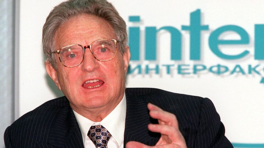 American financer George Soros speaks to reporters Wednesday, March 4, 1998 in Moscow. Soros pledged