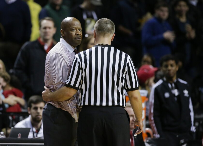 Arkansas head coach Mike Anderson is escorted away by a referee after getting a technical during the second half of an NCAA college basketball game against Stanford in the consolation round of the NIT Season Tip-Off tournament Friday, Nov. 27, 2015, in New York. Stanford won 69-66. (AP Photo/Frank Franklin II)