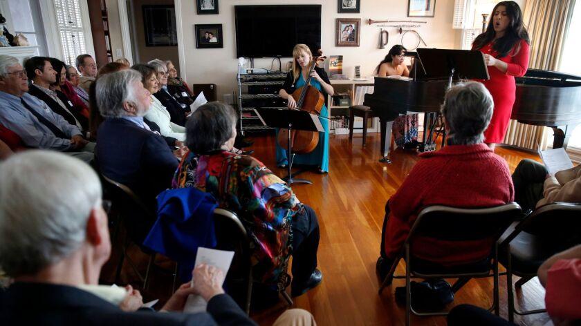 Cellist Erin Breene, pianist Ines Irawati and soprano Priti Gandhi perform in the living room of arts benefactors Marty and Sherry Bloom of La Jolla.