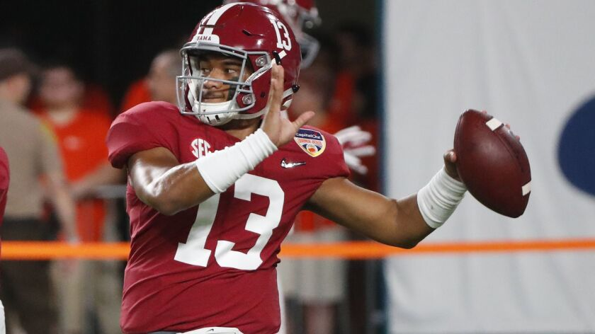 Alabama quarterback Tua Tagovailoa readies to throw a pass.