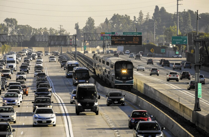 Metrolink's San Bernardino Line snakes its way along the 10 Freeway in Alhambra. The agency is adding two trains to the line during rush hour and eliminating express service.