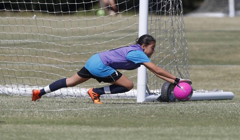 Costa Mesa Victoria Elementary goalie Hailie Enciso blocks a shot. By Costa Mesa Whittier in a girls