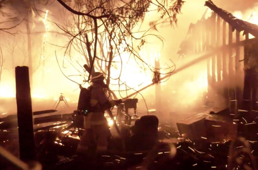Firefighters battle a blaze that destroyed a home in San Bernardino County.