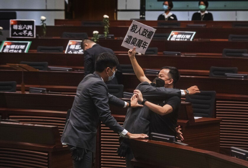 Lawmaker Chan Chi-chuen scuffles with security guards