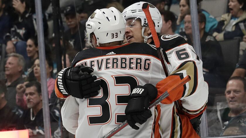 Ducks center Rickard Rakell celebrates with right wing Jakob Silfverberg after Rakell scored a goal against the San Jose Sharks during the second period Wednesday.
