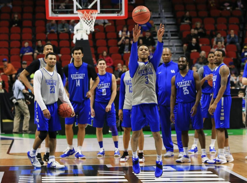 Kentucky's Tyler Ulis (3) shoots from half-court during practice for a first-round men's college basketball game in the NCAA Tournament in Des Moines, Iowa, Wednesday, March 16, 2016. Kentucky will play Stony Brook on Thursday. (AP Photo/Nati Harnik)