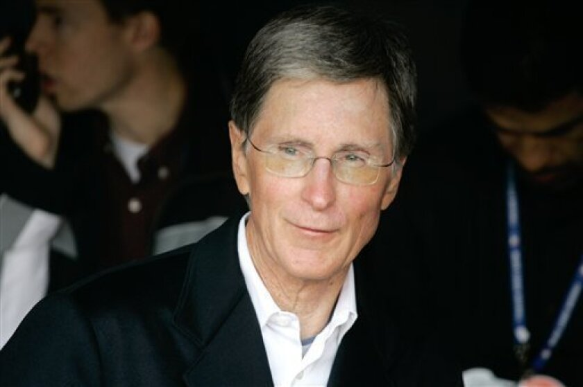 FILE - Boston Red Sox principle owner John W. Henry is shown before the start of Game 3 of the baseball World Series against the Colorado Rockies in this Oct. 27, 2007 file photo taken at Coors Field in Denver. Liverpool's board agreed to sell the Premier League club to the owners of the Boston Red Sox on Wednesday Oct. 6, 2010, although they warned that legal action will have to be taken against the existing American owners to force the takeover. (AP Photo/Jack Dempsey, File)