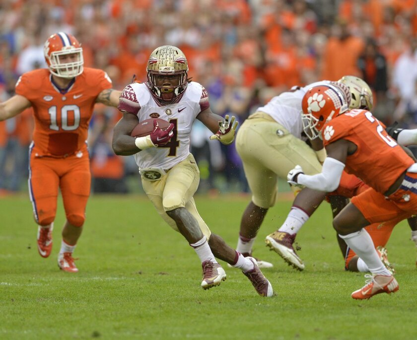 Florida State running back Dalvin Cook (4) rushes out of the backfield for a first down during the first half of an NCAA college football game against Clemson Saturday, Nov. 7, 2015,  in Clemson,  S.C.  (AP Photo/Richard Shiro)