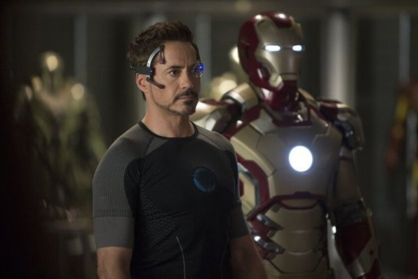 """Robert Downey Jr. stars in """"Iron Man 3,"""" which is about to cross the $1-billion milestone at the box office."""