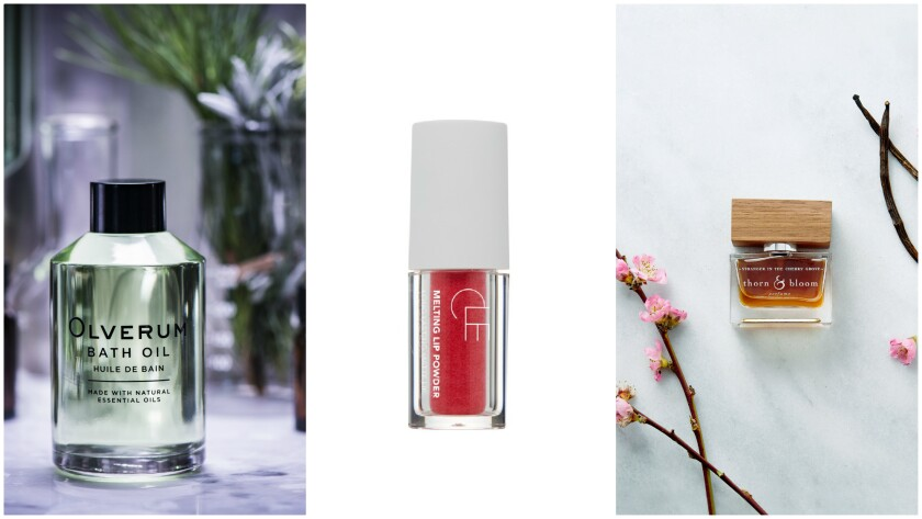 Olverum bath oil, from left, melting lip powder from Cle Cosmetics and a fragrance from Thorn & Bloom.