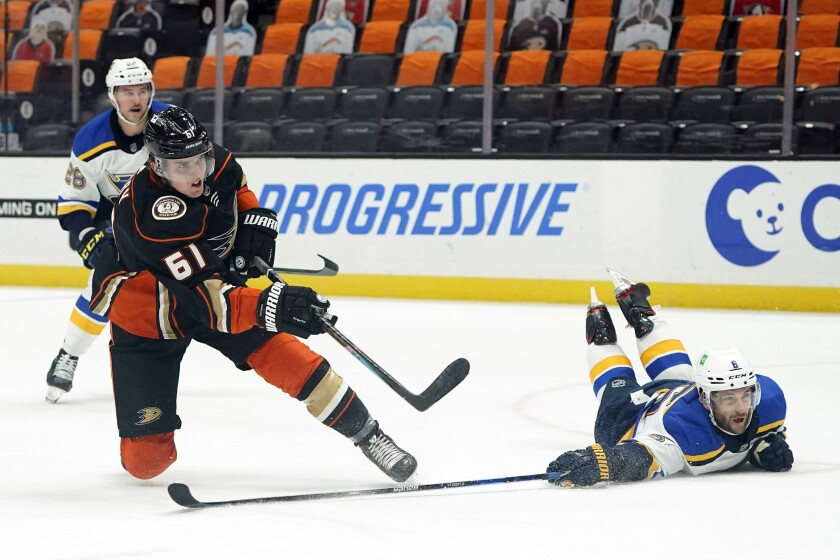Ducks right wing Troy Terry takes a shot on goal as St. Louis Blues defenseman Marco Scandella defends.