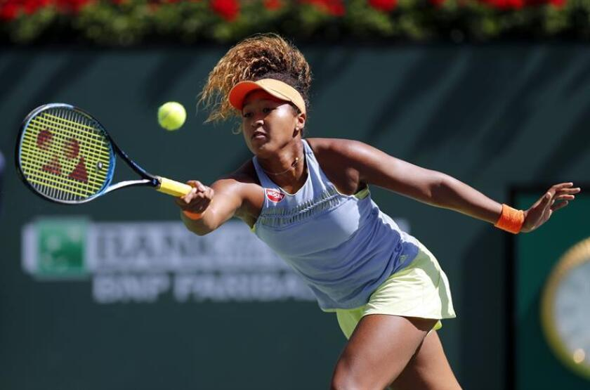 Naomi Osaka from Japan in action against Daria Kasatkina from Russia in their finals match of the BNP Paribas Open at the Indian Wells Tennis Garden in Indian Wells, California, USA, 18 March 2018. EFE