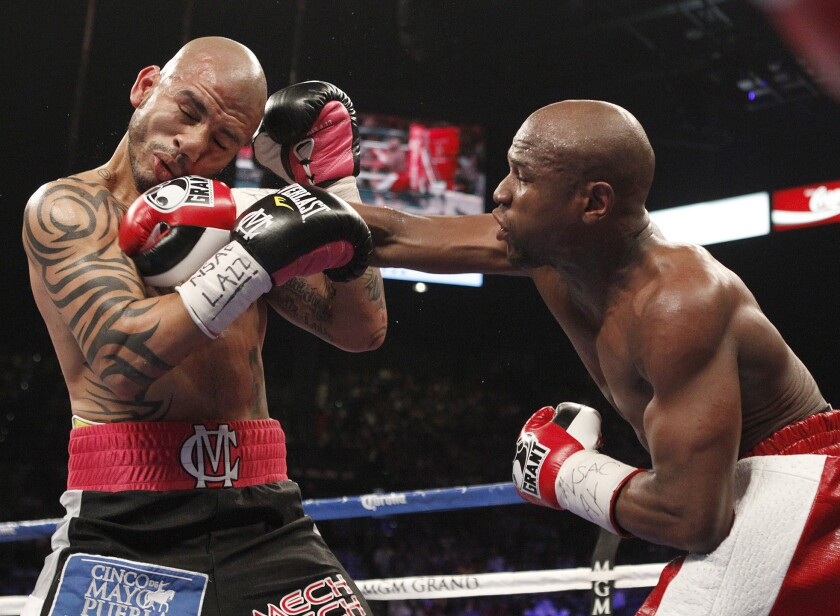 Floyd Mayweather Jr. hits Miguel Cotto during their May 5, 2012, bout.