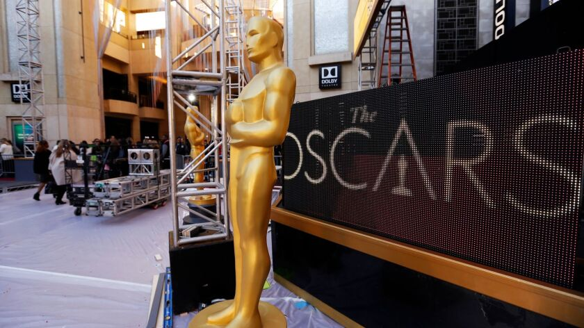 Workers make Oscar ceremony preparations in front of the Dolby Theatre in Hollywood on Thursday.