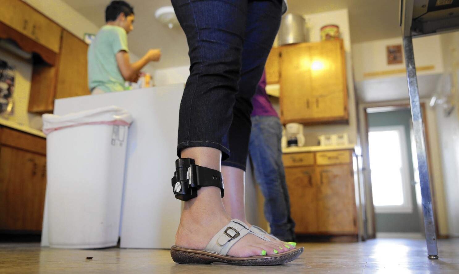 Immigrants object to growing use of ankle monitors after detention