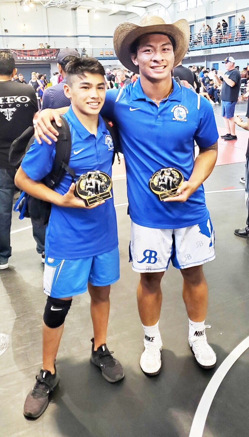 Jacob Jones and Javen Jovero after winning their state titles.