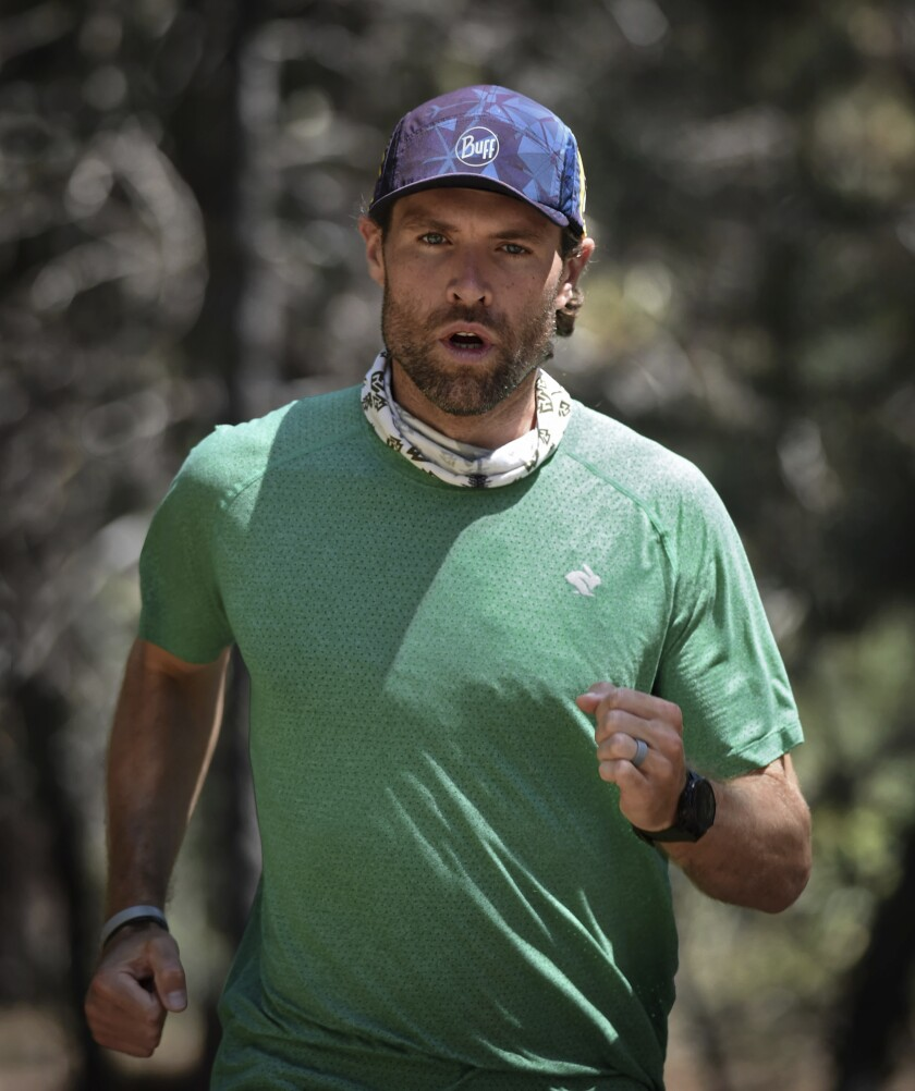 Professional runner Adam Kimble runs at Lake Tahoe on July 29, 2020. On July 18, the Tahoe City resident crushed the previous record for the fastest known time for a supported run on the Tahoe Rim Trail, a roughly 170-mile (273-kilometer) path that circumnavigates Lake Tahoe. He completed the feat in 37 hours, 12 minutes and 15 seconds, almost an hour and a half faster than the previous record. (Andy Barron/The Reno Gazette-Journal via AP)