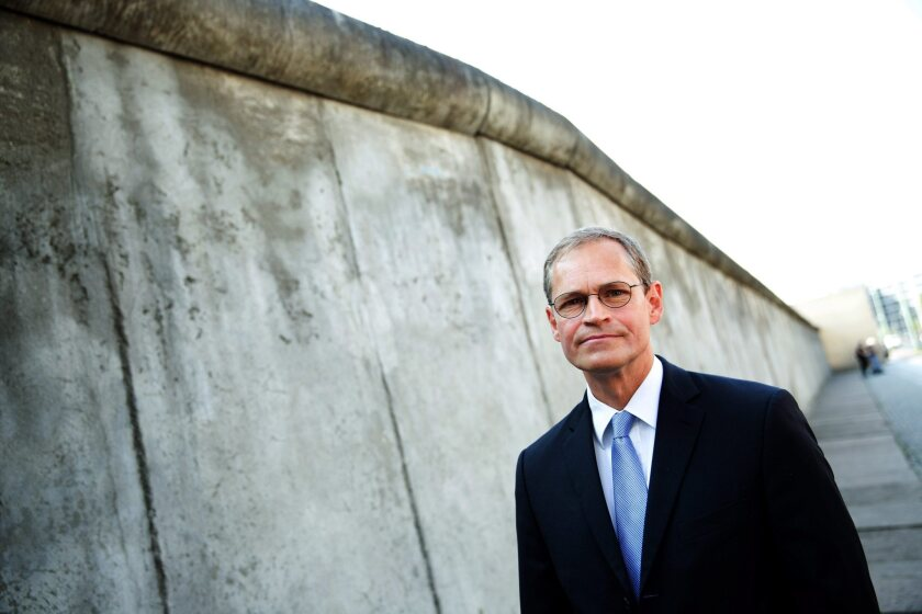 Berlin Mayor Michael Mueller, shown visiting the Berlin Wall Remembrance Site in August, is known for his low-key personality.