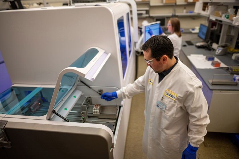 A machine to test for the coronavirus is demonstrated at UC Davis.