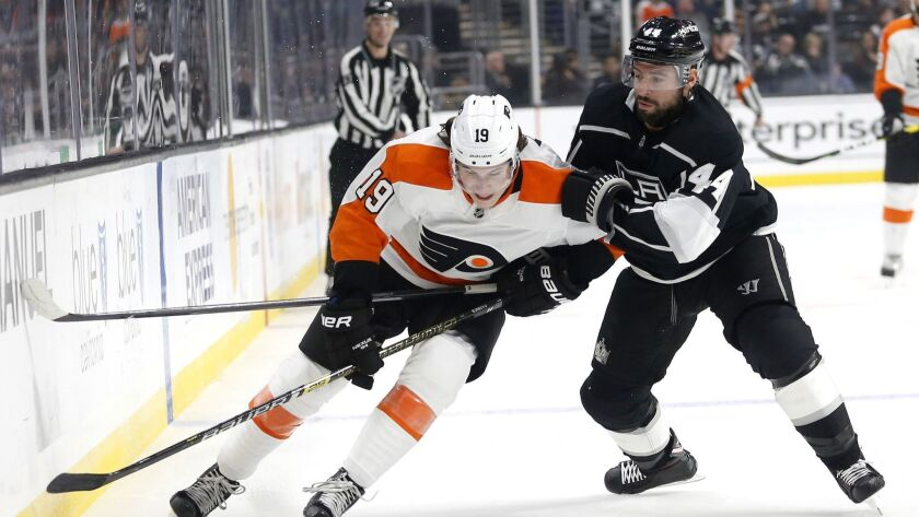 Philadelphia Flyers forward Nolan Patrick and Kings forward Nate Thompson vie for the puck during the first period of a Nov. 1 game at Staples Center.