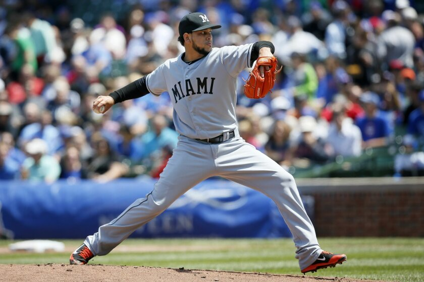 Miami Marlins starting pitcher Henderson Alvarez delivers against the Chicago Cubs during the first inning of a baseball game on Sunday, June 8, 2014, in Chicago. (AP Photo/Andrew A. Nelles)