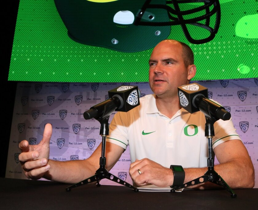 Oregon head coach Mark Helfrich speaks at the Pac-12 NCAA college football media day in Los Angeles Thursday, July 14, 2016. (AP Photo/Reed Saxon)