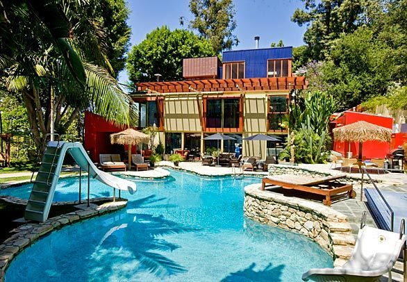This eclectic home in the Beverly Hills Post Office area, designed by architect Alex Istanbullu, is listed at $5.85 million. The main house has four bedrooms, four full bathrooms and two half-baths in 7,311 square feet.