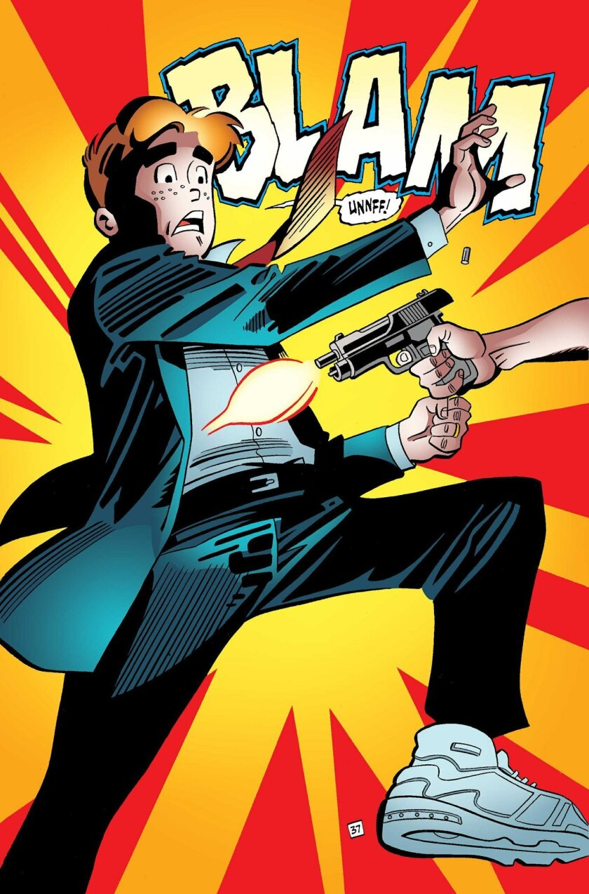 """This photo provided by Archie Comics shows Archie in his final moments of life in a scene from the comic book, """"Life with Archie,"""" issue 36. Archie Andrews will die taking a bullet for his gay best friend. The famous freckle-faced comic book icon will die in the July 16, 2014 installment of """"Life with Archie"""" while intervening in the assassination of Kevin Keller, Archie Comics' first openly gay character. (AP Photo/Archie Comics)"""