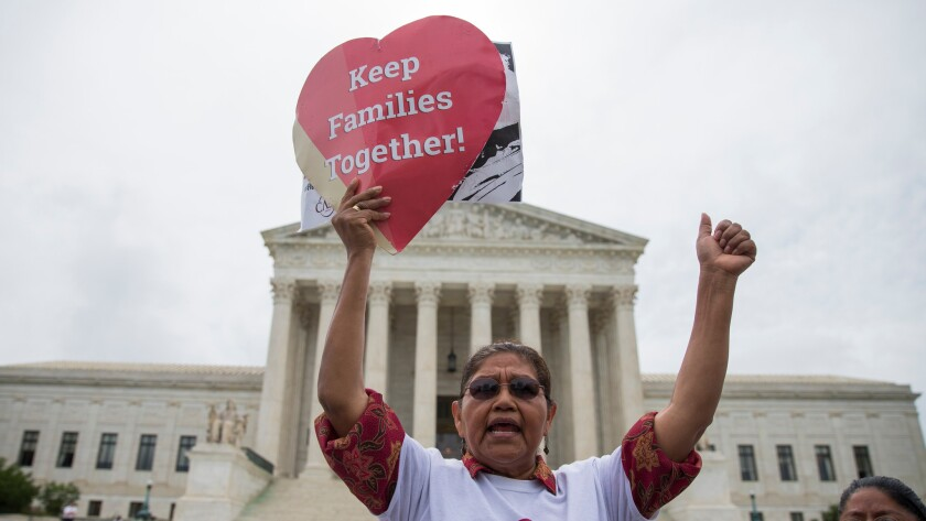 Antonio Surco of Silver Spring, Md., participates in a demonstration outside the U.S. Supreme Court on Thursday.