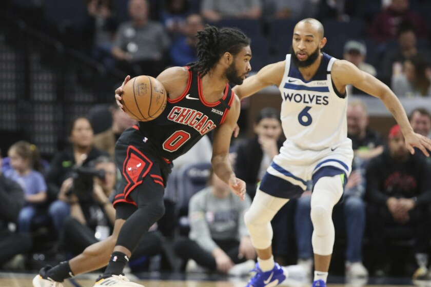 Chicago Bulls' Coby White, left, drives around Minnesota Timberwolves' Jordan McLaughlin in the first half of an NBA basketball game Wednesday, March 4, 2020 in Minneapolis. (AP Photo/Jim Mone)