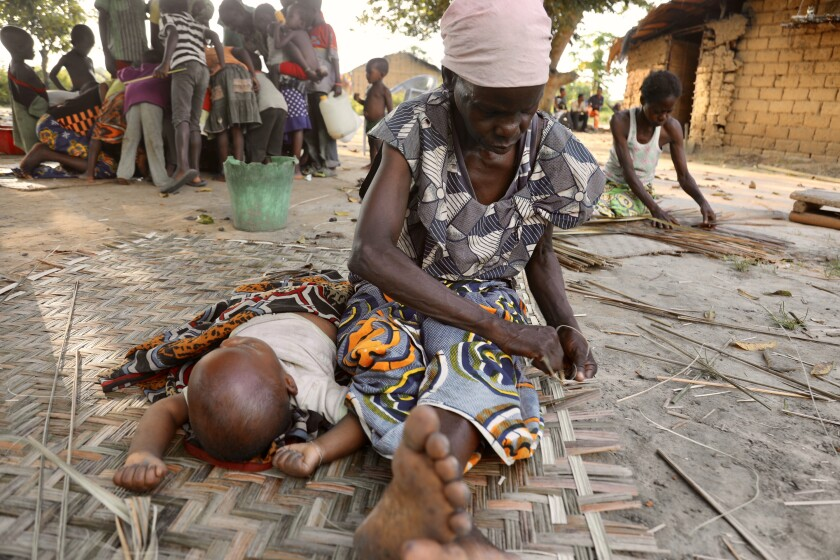 Women weave mats from arrowroot leaves.