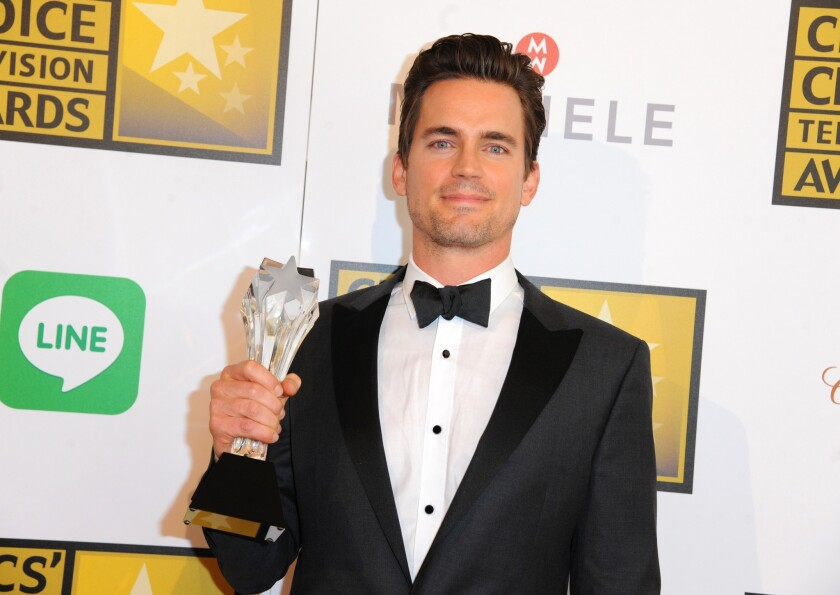 """Matt Bomer with his award for supporting actor in a movie or miniseries for HBO's """"The Normal Heart."""""""