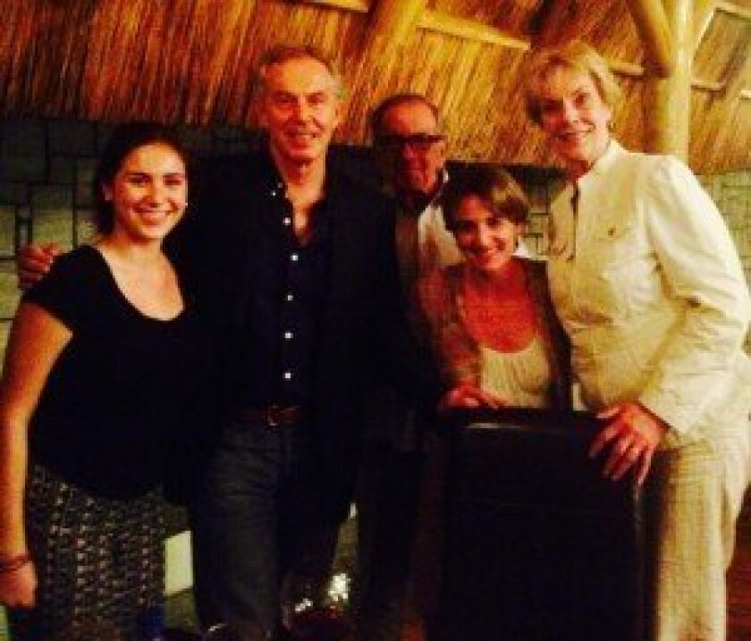 Former British Prime Minister Tony Blair (second from left), who the couple met on their trip.
