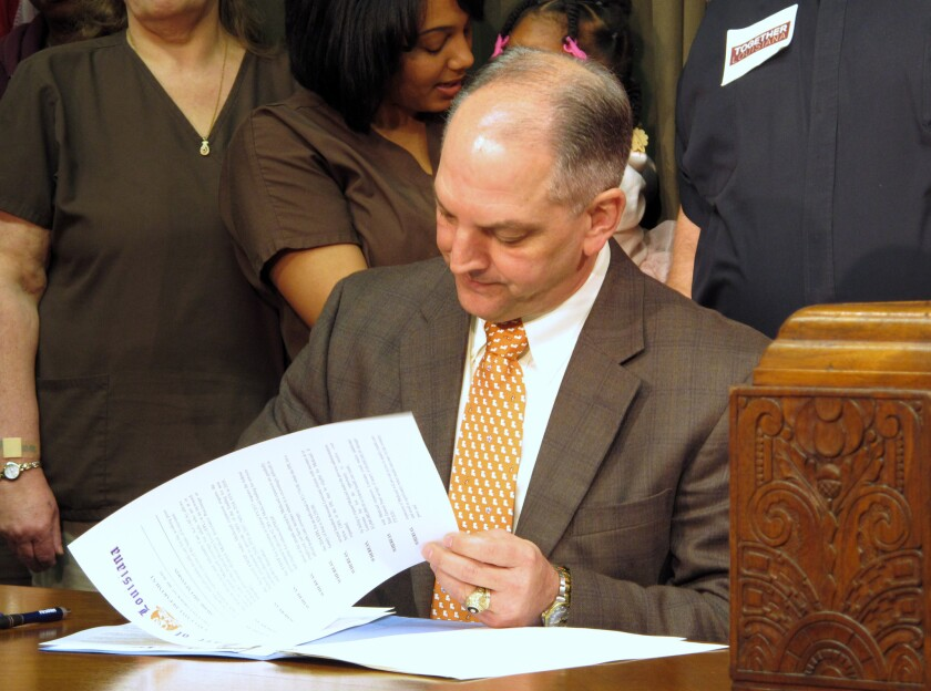 Another domino falls: Louisiana Gov. John Bel Edwards signs an order expanding Louisiana's Medicaid program on Jan. 12, his first day in office.