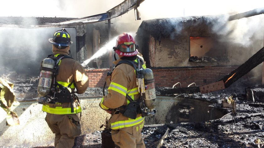 A person was found dead in a house fire on Dos Picos Park Road east of Poway Thursday morning, a fire official said.