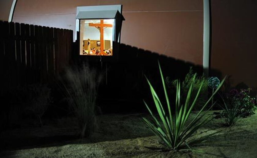 Desert plants surround the new building of Sanctuary of Our Lady of Guadalupe in Mecca, Calif. Though theirs is one of the poorest congregations in the state, parishioners gave what they could to help get the church built. They had met inside a tent with no air conditioning or bathrooms. More photos >>>